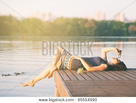Relaxing Woman In City Park Near River