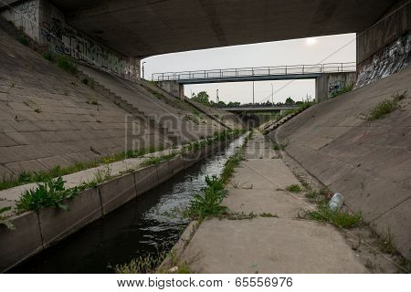 Sewage canal outdoors with water