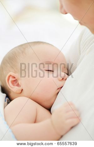 Baby having mom's care