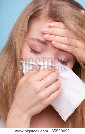 Flu Fever. Sick Girl Sneezing In Tissue. Health