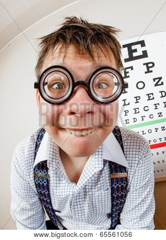 Funny boy wearing spectacles in an office at the doctor