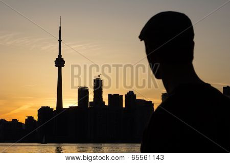 Man Gazing Towards The City Of Toronto