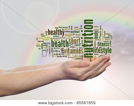 Concept or conceptual abstract nutrition and health word cloud man hand, rainbow sky background