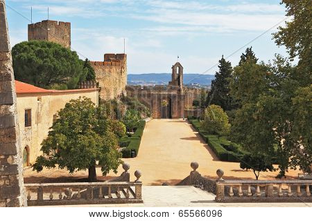 Palace of the Knights Templar in Portugal. Stone fence and the entrance to the park