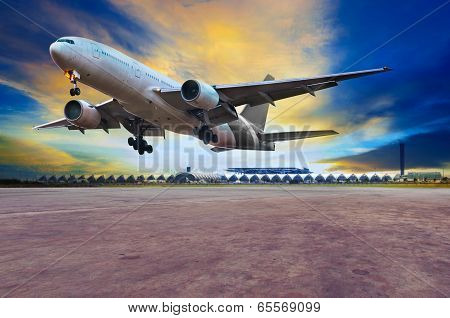 Passenger Jet Plane Landing On Air Port Runways Against Beautiful Dusky Sky Use For Travel Business