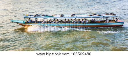 People Travel In The Typical Long Boat At The River Mae Nam Chao Phraya In Bangkok