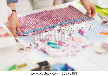 Closeup On Seamstress Measuring Fabric