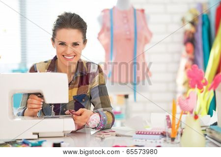 Happy Seamstress Sewing In Studio