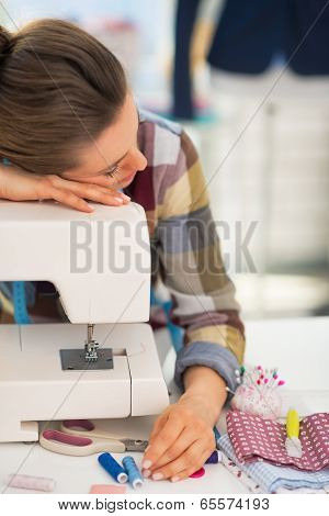 Tired Seamstress Sleeping On Sewing Machine