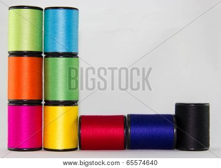set of color threads on a white background