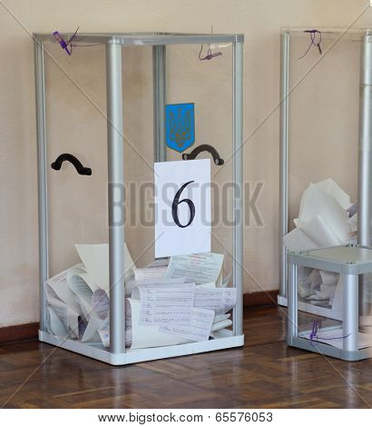 KIEV, UKRAINE - May 25, 2014: Vote for the early presidential elections in Ukraine, voting box with ballots
