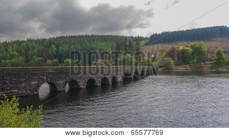 Arched, Stone Bridge Over a Lake