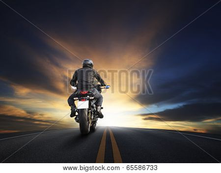 Young Man Riding Big Bike Motocycle On Asphalt High Way Against Beautiful Dusky Sky Use For Biker Tr