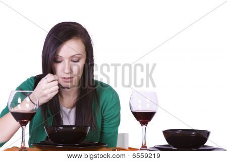 Beautiful Woman Eating Dinner Alone