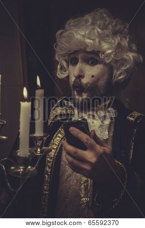 Selfie, funny man with white wig and candlestick nineteenth century