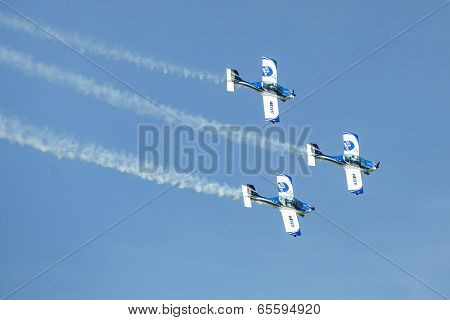 BERLIN, GERMANY - MAY 21, 2014: Aerobatic team 3x Fly Sinthesis Texan Top Class (Wefly team, Italy) performance during the International aviation and space exhibition ILA-2014.