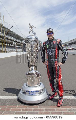 Indianapolis, IN - May 19, 2014:  Kurt Busch (26) poses with the Borg-Warner Trophy before practicing for the Indianapolis 500 IndyCar race in Indianapolis, IN.