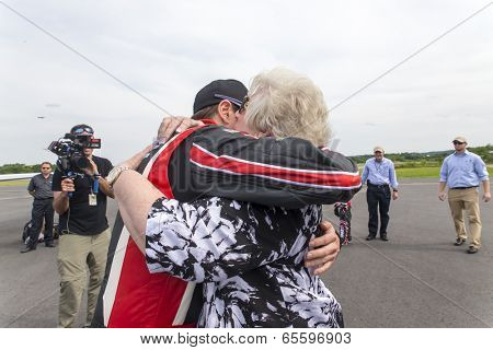 Concord, NC - May 25, 2014:  NASCAR driver, Kurt Busch (26), embraces his family after completing the Indianapolis 500 IndyCar race and landing at Concord Regional Airport in Concord, NC.