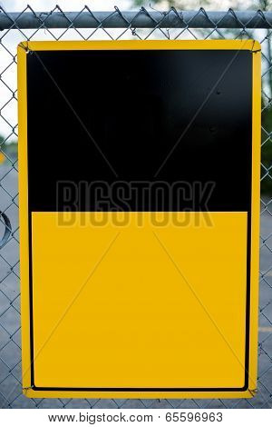Blank Yellow Sign On Chain-link Fence