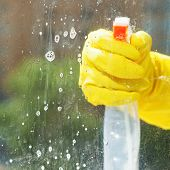stock photo of soapy  - soapy detergent on window glass during washing from spray bottle - JPG