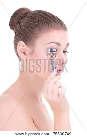 Portrait Of Young Beautiful Woman Curling Her Eyelashes With Eyelash Curler Isolated On White