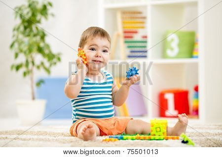 funny kid playing at home or at kindergarten