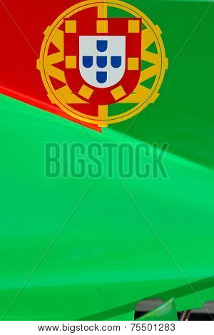 The colors and crest of the national flag of Portugal painted on the body work of a race car