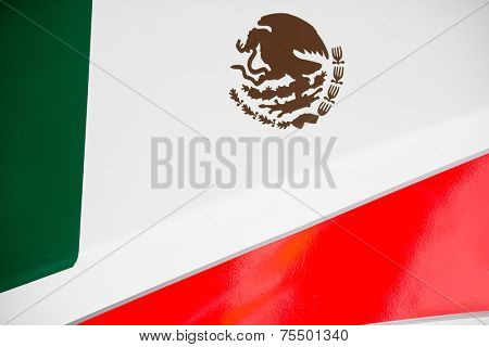 The colors and crest of the national flag of Mexico painted on the body work of a race car