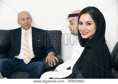 Businesspeople in office, Arabian Businesswoman wearing Hijab against colleagues meeting, Arabian Bu
