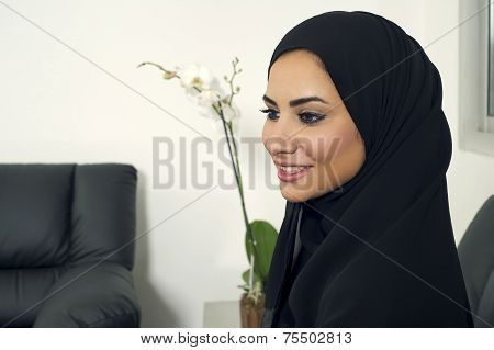 young arabian businesswoman indoors, Arabian Businesswoman wearing Hijab in office