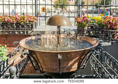 Old Fountain In The Main Square Of Sibiu