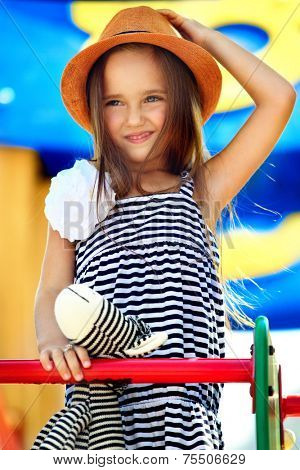 little girl on outdoor playground equipment