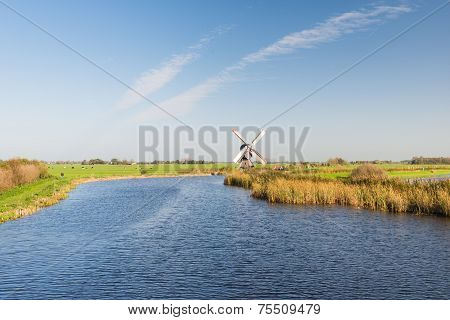 Flat Landscape With Windmill