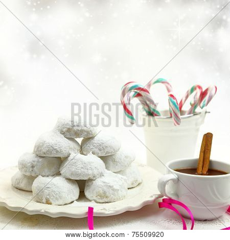 Christmas cookies with candies and coffee on white bokeh background