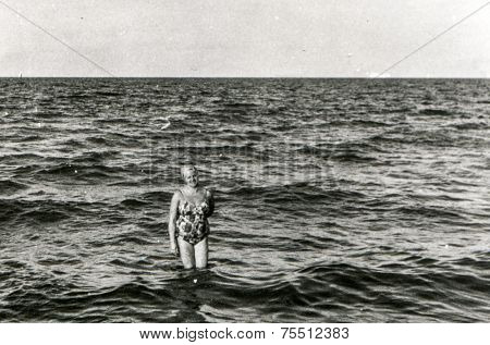 Vintage photo of woman in sea, fifties