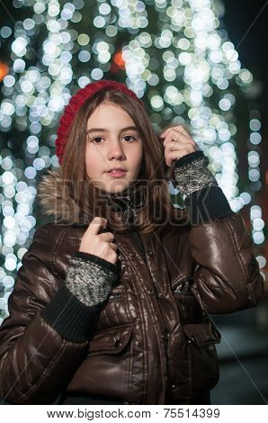 Fashionable Teenage Girl Wearing Cap And muffler Coat outdoor With Snow