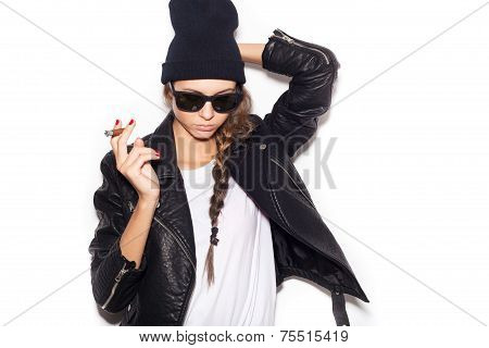 Hipster Girl In Sunglasses And Black Leather Jacket Smoking Cigar