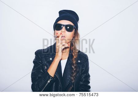 Sexy Girl In Sunglasses And Black Leather Jacket Smoking Cigar