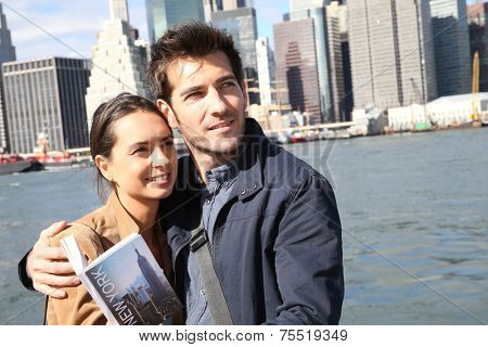 Couple of tourists reading New York city guide
