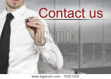Businessman Writing Contact Us In The Air