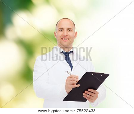 medicine, profession, environment and healthcare concept - smiling male doctor with clipboard writing prescription over natural background