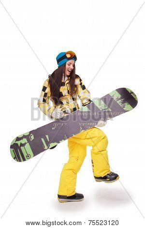 Young woman simulating the guitar playing with snowboard