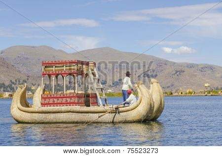PUNO, PERU, MAY 5, 2014: Uros islands on Titicaca lake - Local man leads his