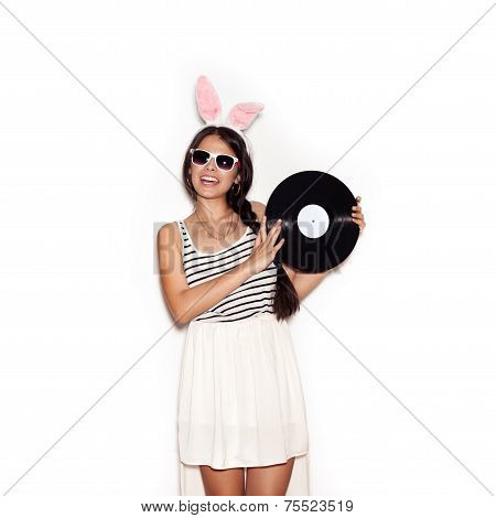 Sweet Girl Having Fun With Musical Plate On White Background