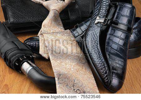 Classic Men's Shoes, Tie, Umbrella  And Bag On The Wooden Floor