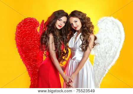 Beautiful Brunette Angel Girls With Angel's Wings. Fashion Women With Long Wavy Hair Wearing In Red