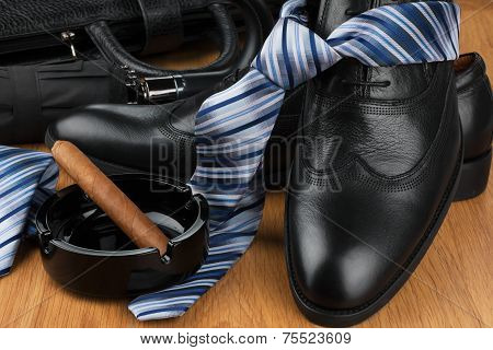 Classic Men's Shoes, Tie, Umbrella, Cigar, Ashtray  And Bag On The Wooden Floor