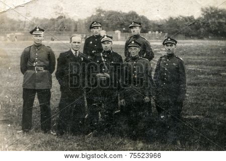 POLAND, CIRCA THIRTIES: Group of soldiers in uniforms poses outdoor