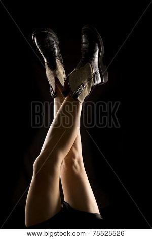 Woman Legs Up On Black Back Lit Boots