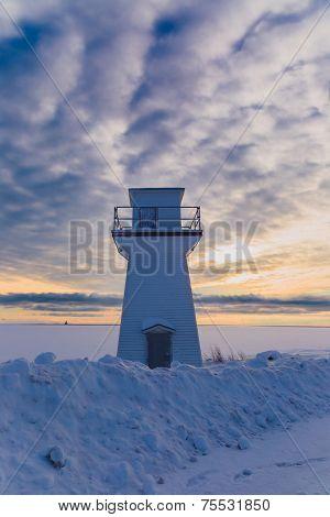 Lighthouse or range light along the waterfront of Summerside, Prince Edward Island at sunset.